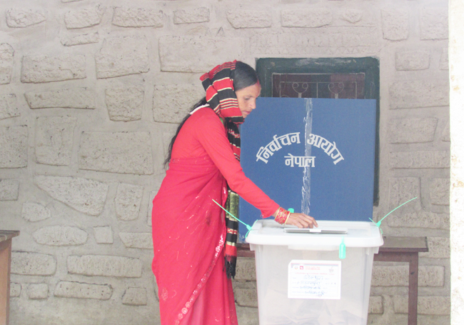 A woman casts her vote in the second phase of local elections in Dadeldhura last week. Pic: Bachu BK