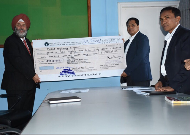 https://archive.nepalitimes.com/assets/uploads/gallery/13148-Handing-Over-of-Cheque19717.jpg