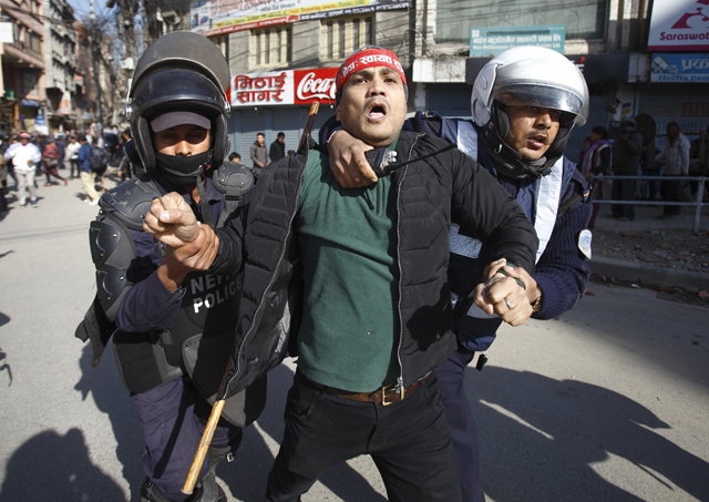https://archive.nepalitimes.com/assets/uploads/gallery/30286-Police-personnel-detain-strike-enforcer.jpg