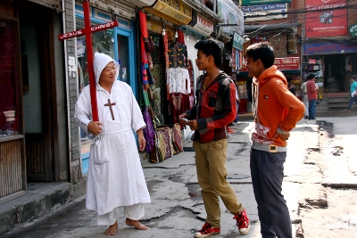 https://archive.nepalitimes.com/assets/uploads/gallery/bf72a-A-Japanese-walks-around-evangelising-in-Thamel-on-Tuesday-afternoon.jpg