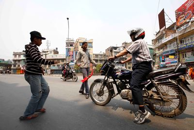 https://archive.nepalitimes.com/assets/uploads/gallery/c799a-Protestor-trying-to-get-motorbike---s-key-at-kalimati-1.JPG