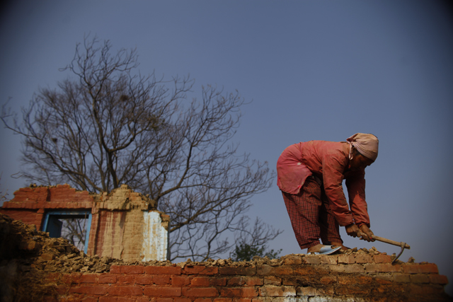https://archive.nepalitimes.com/assets/uploads/gallery/f3a10-Woman-labourer-reconstructing-house.JPG