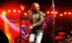 https://archive.nepalitimes.com/image.php?&width=250&image=/assets/uploads/gallery/994d4-1.-Nepathya-frontman-Amrit-Gurung-in-action-in-Narayanghat---Photo---Sudhira-Shah.jpg