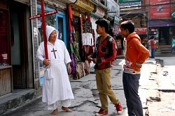 https://archive.nepalitimes.com/image.php?&width=250&image=/assets/uploads/gallery/bf72a-A-Japanese-walks-around-evangelising-in-Thamel-on-Tuesday-afternoon.jpg